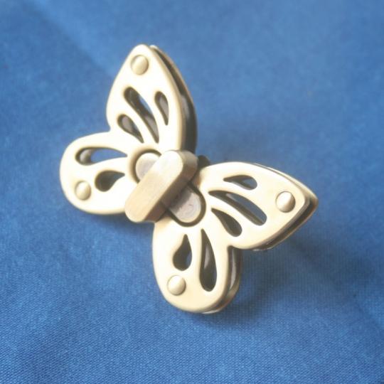fermoir tourniquet papillon
